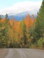 На Денежкином - снег. Внизу - золотая осень.